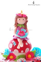 Fairy Abi! (Little Cottage Cupcakes) Tags: birthday pink flowers blue cake daisies cupcakes purple butterflies caterpillar fairy ladybird ladybug toadstool fairies magical fondant sugarpaste littlecottagecupcakes