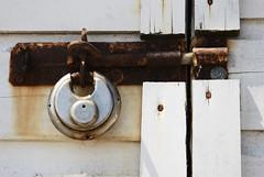 Locked (robert_a_dickinson) Tags: white coast seaside nikon beachhut padlock locked essex waltononthenaze sigma2470f28 d80