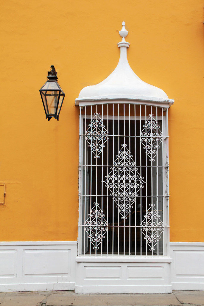 Colonial white window on orange wall