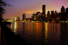 New York at Sunset (` Toshio ') Tags: toshio nyc eastriver queensborobridge rooseveltisland reflections chryslerbuilding unbuilding unitednations sunset america usa fujixe2 xe2 manhattan midtown river cityscape city