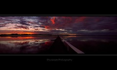 Out Of This World (rhyspope) Tags: morning blue sunset red sky orange cloud mountain lake storm black hot reflection tree water yellow clouds creek sunrise canon river painting landscape evening pier wooden amazing warm heaven skies bright ripple jetty horizon australia lagoon glorious filter wharf nsw newsouthwales railing aussie centralcoast plank warming pontoon gosford 500d tuggerah theentrance longjetty rhyspope