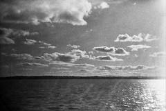 Cute Clouds (western4uk) Tags: liverpool merseyside otterspool ilfordhp5plus rivermersey otterspoolpromenade otterspoolprom holga135bc
