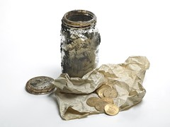 The coins and the kilner jar they were buried in