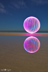 Ball of Light - Infinity (biskitboy) Tags: ocean longexposure nightphotography sea sky lightpainting color colour reflection water reflections circle stars lights sand colorful purple bright artistic orb balls australia led reflect round paintingwithlight adelaide sa orbs southaustralia circular lightart balloflight lightball lapp flickraward denissmith flickraward5