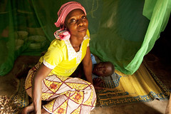 World Malaria Day: Inadequate mosquito nets (Christian Aid Images) Tags: poverty baby mother health impact nets disease malaria worldmalariaday