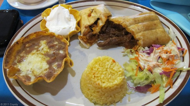 Steak chimichanga with rice, beans, sour cream, and salad