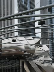 Pritzker Pavilion (Ir. Drager) Tags: park trip urban usa chicago 2004 geotagged illinois milleniumpark highrise mcd frankgehry excursion urbanplanning studytrip urbandevelopment pritzkerpavilion aquatower mastercitydeveloper