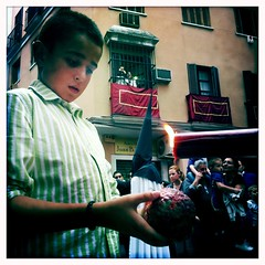 Boy collecting candle wax from the Nazarenas #ssanta #seville #iaow [click link/photo] (iamoneworld) Tags: santa boy mobile solar sevilla spain energy candle seville andalucia holy week wax procession semana processie kaarsvet nazarena iamoneworld iphoneography iaow