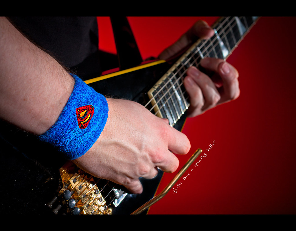 Project 365, Day 258, 258/365, Strobist, Self Portrait, Bokeh, Sigma 50mm F1.4 EX DG HSM, 50 mm, 50mm, Superman, Guitar, Jackson Rhoads Custom Shop, Jackson CS Rhoads, Randy Rhoads, floyd rose, picking, faster than a speeding bullet, superman, wristband,