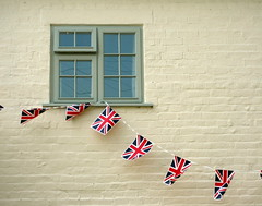 Bunting in Eckington (Katie-Rose) Tags: uk white window wall reflections painted cottage worcestershire unionjack unionflag brickwork bunting royalwedding eckington katierose jarvisstreet williamandkate april2011 opengardensweekend canondigitalixus95is princewilliamandcatherinemiddleton dukeandduchessofcambridge