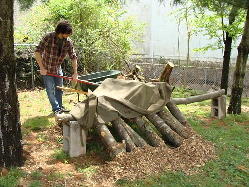 Volunteer Phil Shovelling Wood Chips