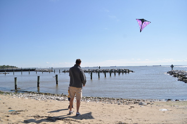 flying her first kite with dad