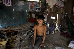 Steung Meanchey, Phnom Penh -  Home! (Mio Cade) Tags: poverty boy house kid cambodia child floor sponsor phnom scavenger penh wstreet cheoung steung meanchey