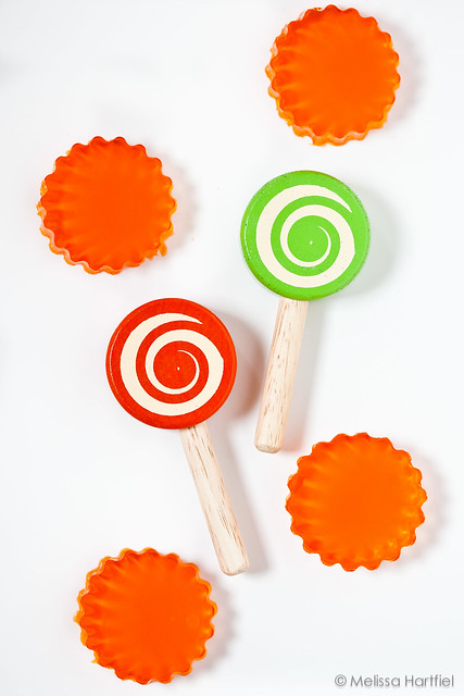 Two wooden lollipops with jellow stars