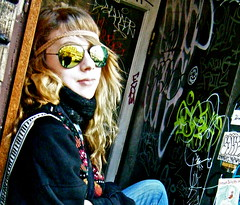 a moment to reflect (skintone) Tags: light portrait toronto ontario canada reflection beauty face scarf dark graffiti mirror paint brother daughter longhair tags jeans doorway reflect collegestreet imagine cousin 16 moment pause aviators headband rosalie skintone itsmulticolored beautifulexpression tgamphotodeskgraffiti