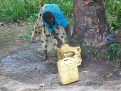 A woman cleans her jerry can