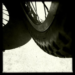 Shadow Wheel (sunraa) Tags: shadows assignment squareformat 505 bicyclewheel bsquare project365 dailyshoot iphone4 unusualpointofview johnslens hipstamatic claunchfilm