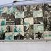 [senza titolo]; 1998. Fotografia con schermo in policarbonato, ferro; <br /> cm 200x300.<br /> Maglione, Via Cavour.<br />