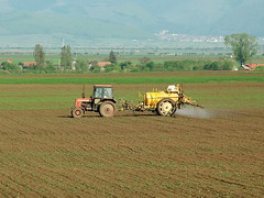 Spraying (Dakota Local) Tags: summer cloud mountain tractor toxic field yard rural truck work countryside spring village earth farm country meadow spray works worker material farmer agriculture chemicals far agricultural spraying pesticide