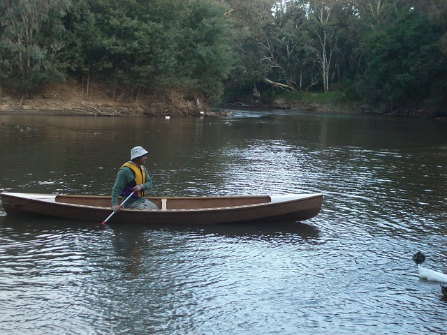 Paddling their new DIY canoe on the river