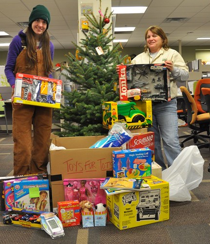 ALB staff with their Toys for Tots donations. They collected almost 200 toys for the local community.