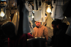 Cold morning (Huey Yoong) Tags: portrait man cold lightbulb japan tokyo lowlight asia market stall tsukiji vendor beanie tsukijifishmarket honshu environmentalportrait peopleportrait winterclothing 5photosaday tsukijicho nikond700 nikkor28300mmvr