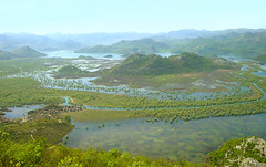 skadar lake- magic montenegro (sandra.d.) Tags: blue lake mountains green nature water beauty landscape nationalpark village view magic montenegro   crnagora jezero  skadarskojezero cetinje formyman pejzaz  vranjina skadarlake   dodosi bobija sandradjurbuzovic    carevlaz podgoricacetinje pogledsbobije cudonevidjeno riverkaratuna rijekakaratuna