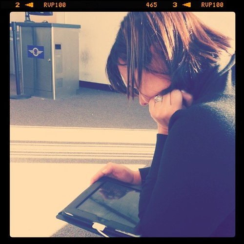 Project 365 105/365: The famous @TiffanyRom reading on her iPad. She reads like a lot....while I read The Twitter.