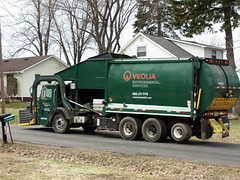 Veolia Environmental Services Garbage Truck. (dccradio) Tags: trees house building tree wisconsin architecture truck cloudy overcast transportation vehicle wi garbagetruck marshfield trashtruck veolia environmentalservices servicevehicle centralwisconsin marshfieldwi m107005
