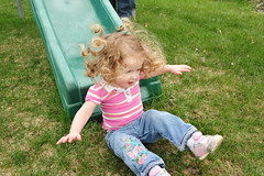 Weebonk (nateOne) Tags: grass yard 35mm hair iso200 flying toddler play action slide landing curly midair schnivic dottie inair 35mmf14 nikond700 1125secatf71 focusdistance150m