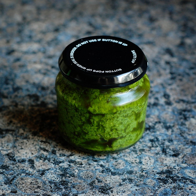 A jar of bright green parsley pesto