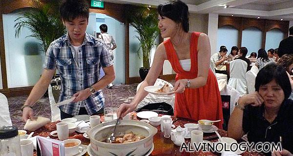 Cherie and Calvin bonding over Dang Gui Chicken