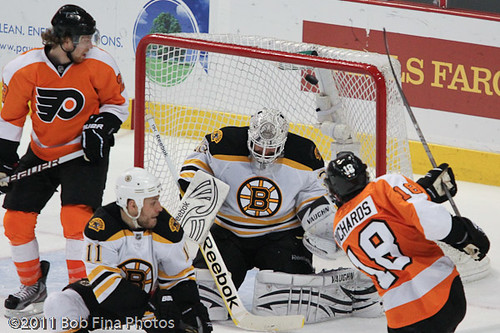 Claude Giroux #28 watches Mike Richards #18 of the Philadelphia Flyers beat both Greg Campbell #11 and Tim Thomas #30 of the Boston Bruins to score his first goal of the playoffs on April 30, 2011 at