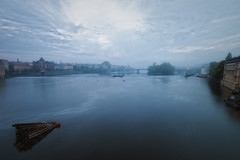 Foggy Vltava (TheFella) Tags: longexposure bridge blue sky mist slr misty fog digital photoshop canon river eos grey photo europe czech prague foggy praha photograph processing slowshutter czechrepublic dslr charlesbridge vltava karlvmost moldau postprocessing 500d mostlegi bridgeoflegions streleckostrov