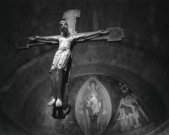Cloisters Cross (El Bizo) Tags: nyc newyork mamiya film architecture analog christ cross medieval 1600 hp5 met ilford cloisters metropolitanmuseumofart 80mm ddx 7ii bizewski