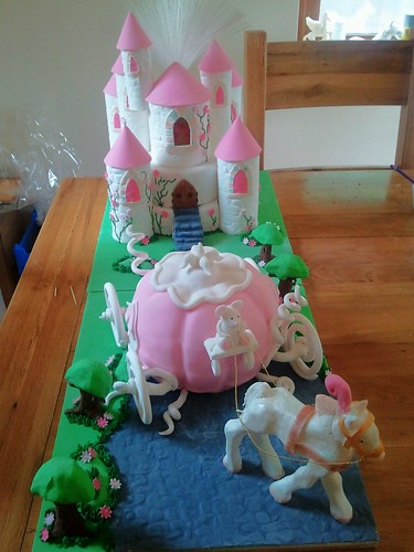cinderella castle, pumpkin coach and glass slipper cake