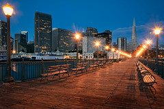 Pier 7 -  Embarcadero (Sebastian (sibbiblue)) Tags: sanfrancisco camera wood longexposure morning skyline architecture night docks sunrise landscape pier lowlight nikon waterfront pyramid dusk availablelight ambientlight embarcadero lamps nikkor transamericapyramid 18105 pier7 nikond7000 equationoflight