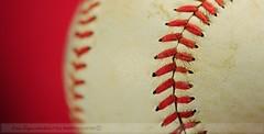 Stitches (disgruntledbaker1) Tags: light red white macro window nikon baseball stitches 60mm monday d90