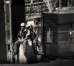 have a break... world trade center memorial (pamela ross) Tags: nyc usa newyork men america pen 50mm construction dof unitedstates minolta bokeh worldtradecenter olympus depthoffield worker ep1