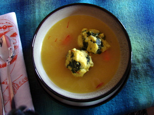 matzo ball soup with spinach and saffron broth