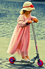 Scooting home from the Royal Wedding celebrations (Lilla~Rose) Tags: uk pink wedding hat child scooter oxfordshire scoot abingdon princewilliam royalwedding theroyalwedding catherinemiddleton throwingbuns dukeandduchessofcambridge abingdonbunthrowing historicoccasions historiccelebrations