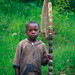 Kid with bamboo stick