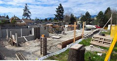 New Condo site Panorama (D70) Tags: new houses homes two panorama canada mountains tree daisies photoshop fence concrete coast is site construction bc photos crane north under taken delta security foundation chain using condo coastal evergreens burnaby forms worker through bobcat avenue hemlock complex parc conifers footings 41 linked inman rmc merged unit tradesman readymix 5655 northparc