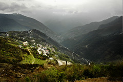 Enroute to Tawang - The small valley near the Sela Pass lights up in the aftenoon sun (Anoop Negi) Tags: road portrait india mountain mountains photography for photo media image bend photos delhi indian side bangalore creative pass images best valley po mumbai anoop himalayas hairpin pradesh negi arunachal sela tawang bends photosof ezee123 bestphotographer imagesof anoopnegi jjournalism tezpore