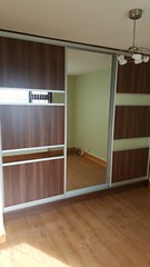 Sliding door wardrobe in walnut with mirror