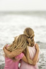 Mother and Daughter at the Beach (Passive Income Dream.com) Tags: ocean family sea 2 vacation two people woman color love beach parenthood girl childhood vertical female children mom outdoors person seaside kid hugging hug sitting child affection daughter young mother lifestyle parent blond photograph shore leisure copyspace rearview caucasian selectivefocus embracing leisureactivity