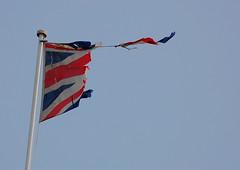 Seen better days (Mrs S.A) Tags: seaside flag felixstowe gamewinner nikond40 flickrchallengegroup flickrchallengewinner 15challengeswinner thechallengefactory pregamesweepwinner