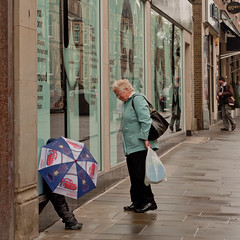 Love and Care (Owain Thomas) Tags: street urban woman love umbrella nikon child cardiff streetphotography queens care d90 nikond90