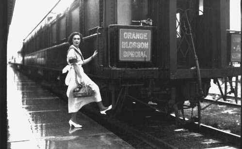 Unidentified woman boarding the Orange Blossom Special train: Sebring, Florida by State Library and Archives of Florida