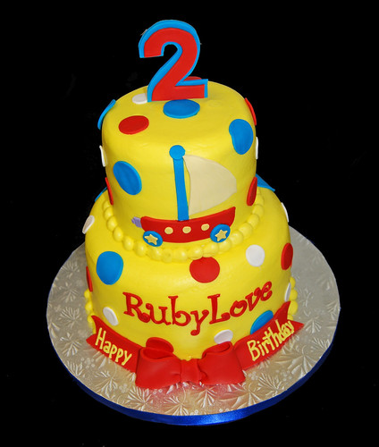 yellow red and blue 2nd birthday cake for a Wonder Pets celebration